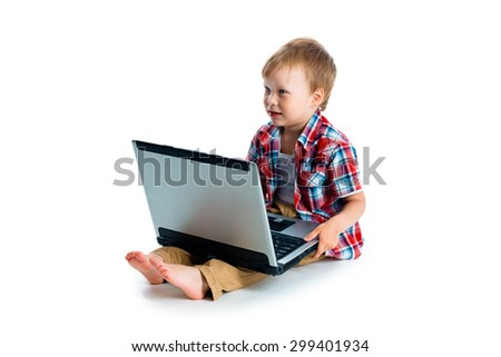 The little blue-eyed boy with a laptop on a white background
