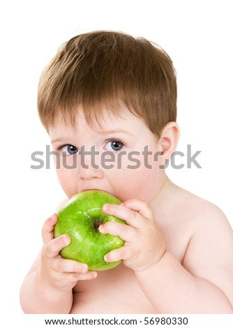 The little boy eats a green apple - stock photo