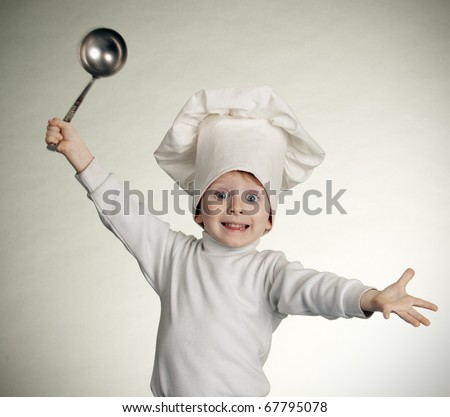 The little boy in a suit of the cook - stock photo