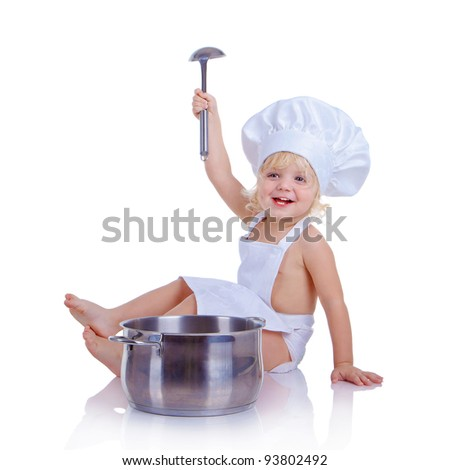 The little boy in a suit of the cook playing with kitchen accessories (isolated on white) - stock photo