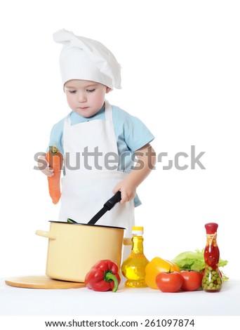 The little boy in hat of cook - stock photo