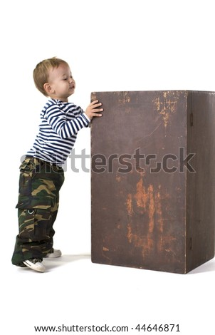The little boy looks in the big box - stock photo