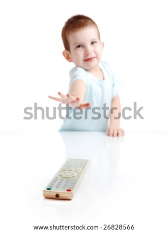 The little boy pulls to a control panel from the TV - stock photo