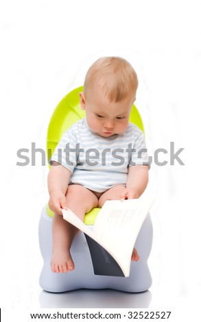 The little boy sits on a chamber-pot and reads the book
