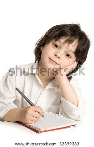 The little boy which drawing of pencil in notebook