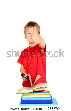 The little boy with books and magnifying glass. Student showing a thumbs up or OK sign. Isolated on white background - stock photo