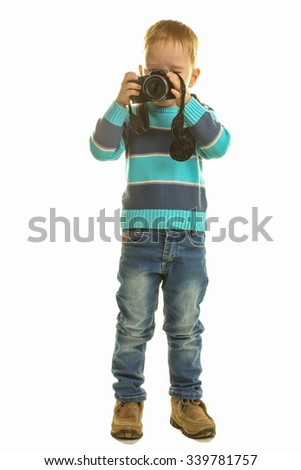 the little boy with the camera on a white isolated background