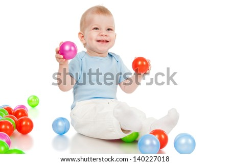 The little boy with toy balls