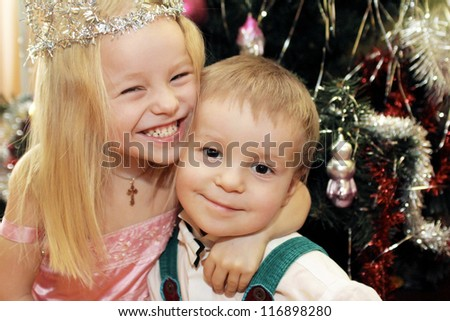 The little children, brother and sister greeted the new year holiday and Christmas. - stock photo