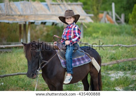 The little cowboy on a black horse