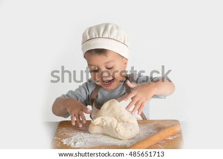 the little culinary specialist kneads the dough with both hands