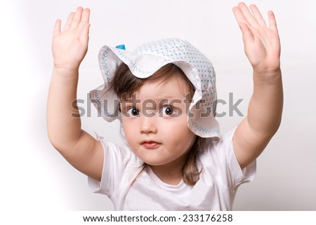 The little funny girl closeup portrait in good mood with hand up - stock photo