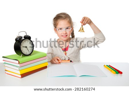 the little girl at school Desk rings the bell - stock photo