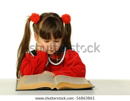 The little girl before the big scientific book. It is isolated on a white background