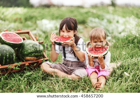 The Little girl eating watermelon.