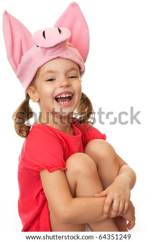 The little girl in a hat cheerful pig.