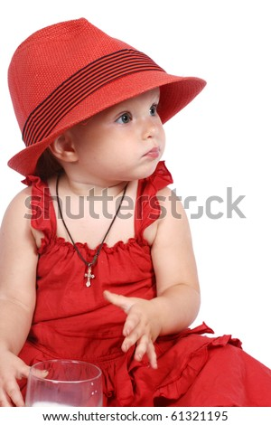 The little girl in a red hat on a white background