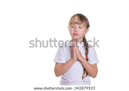 The little girl in a white undershirt prays blindly.