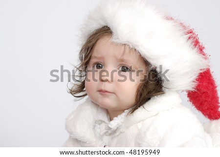The little girl in expectation of new year, in celebratory clothes.