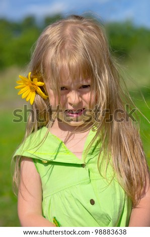 The little girl in the village - stock photo
