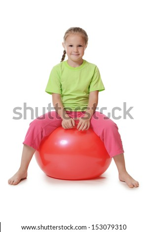The little girl on a gymnastic ball - stock photo