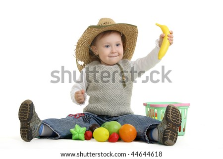 The little girl plays with toy fruit