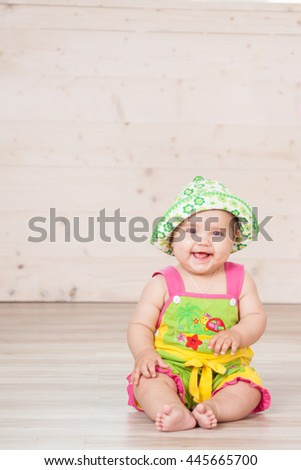 the little girl sitting in the Studio with balls