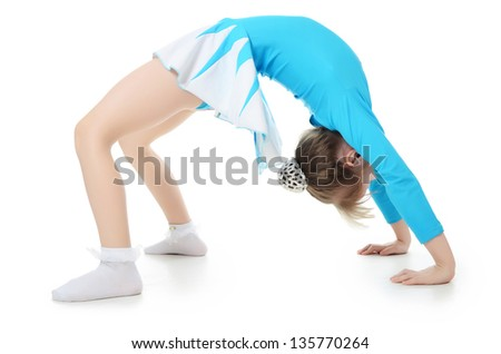The little girl the gymnast does exercise - stock photo