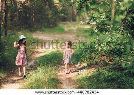The Little girl walk in the forest.