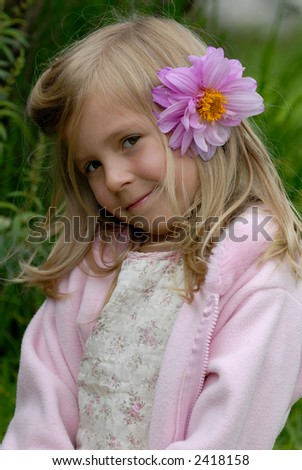 the little girl with a flower in hair - stock photo