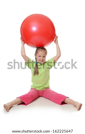 The little girl with a gymnastic ball