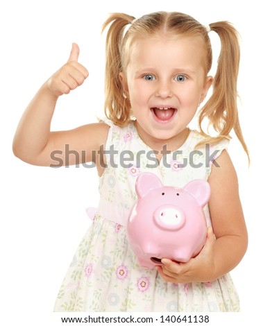 The little girl with a money box - a pig and showing ok. It is isolated on a white background - stock photo