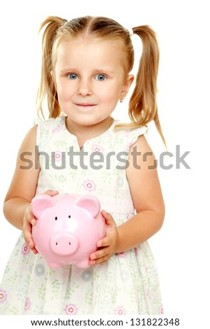 The little girl with a money box - a pig. It is isolated on a white background - stock photo