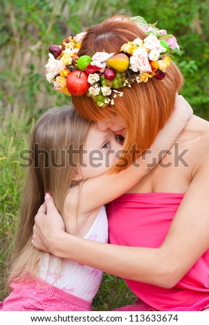 The little girl with mother outdoors - stock photo