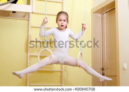 the little gymnast is engaged on a home sports complex - stock photo