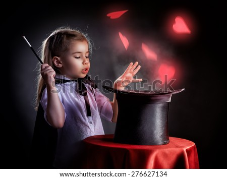 the little magician does tricks - stock photo