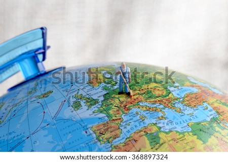 The little man explores the environment globe. The concept of environmental protection. - stock photo