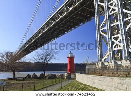 The 'Little Red Lighthouse' underneath the George Washington Bridge on the Hudson River in upper Manhattan in New York, NY - stock photo