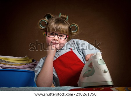the little wife diligently irons, you are very tired. vintage-looking/little wife diligently irons - stock photo