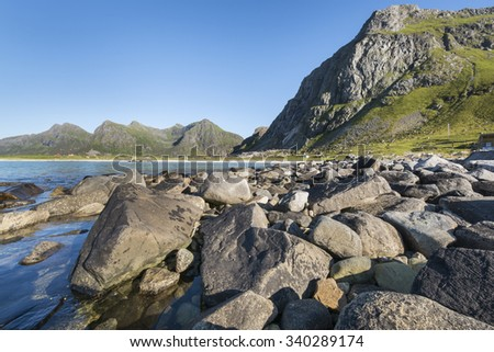 The Lofoten Islands are an archipelago of Norway between the counties of Nordland and Troms unesco heritage fishing for cod. Utakleiv beach - stock photo