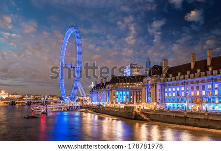 The London Eye at sunset. Panoramic Wheel with Thames reflections. - stock photo