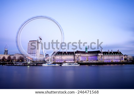 The London Eye is a giant Ferris wheel on the bank of River Thames. It is a European landmark and an iconic symbol of London, England, United Kingdom. - stock photo