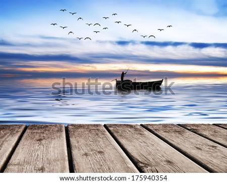 The lone fisherman - stock photo