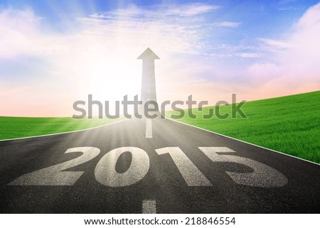 The long highway with upward arrow to the sky, symbolizing the way to better future 2015 - stock photo