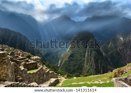 The Lost City of the Incas. Sunbeams on dark mountains. - stock photo