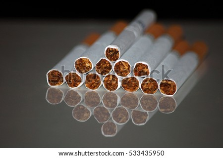 The lot of cigarettes in the form of a pyramid with reflection
