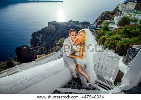 The lovely young couple beautiful woman from handsome man relating to the beautiful Greek landscape