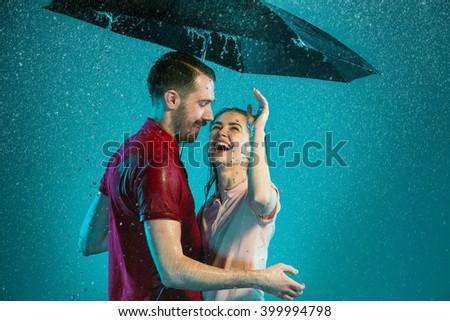 The loving couple in the rain - stock photo