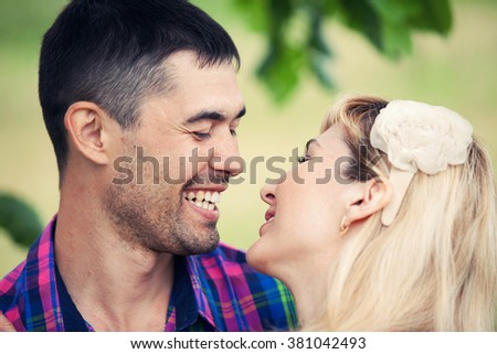 the loving couple smiles closeup outdoors