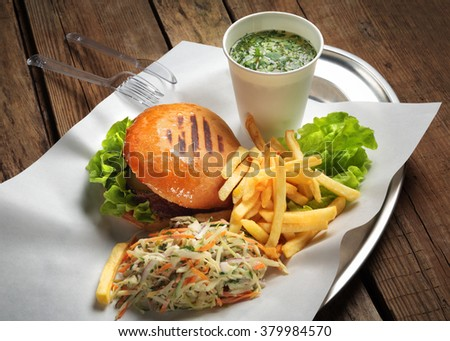 the lunch on a tray with burger and soup - stock photo
